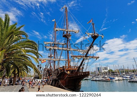 BARCELONA, SPAIN - AUGUST 07:Old frigate moored at Port Vell on August 07, 2012 in Barcelona, Spain. The area has a leisure center, shops and rest called Maremagnum, an IMAX cinema and an aquarium