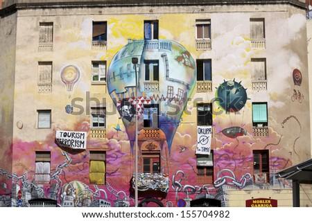 BARCELONA, SPAIN - AUGUST 25. Painted house in Barcelona on August 25, 2013. One of the most active squatters scenes of Europe is in Barcelona. This house is located in the district St. Antoni