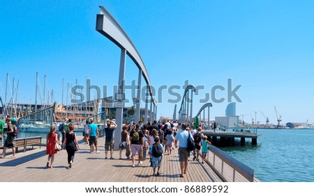 BARCELONA, SPAIN - AUGUST 16: Rambla de Mar and Port Vell on August 16, 2011 in Barcelona, Spain. The area has a leisure center, shops and restaurants called Maremagnum, an IMAX cinema and an aquarium.