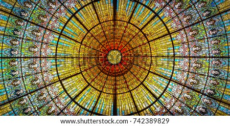Barcelona, Spain - August 1 2013: The colorful glass window ceiling in the Palace of Music in Barcelona. #742389829