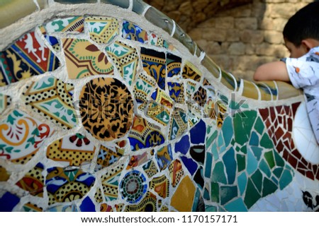 BARCELONA / SPAIN - August 2018: Visitors marvel at the wonders of Antoni Gaudi's Park Güell. Constructed in 1914, the park is home to some of his most famous architectural and mosaic work.  #1170157171