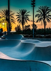 Barcelona, Spain: Concrete skatepark with tubes and jumps at sunset