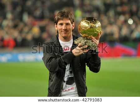 BARCELONA, SPAIN - DEC 12: Messi holds up his Golden ball, before the Spanish league match between Barcelona and Espanyol at the Camp Nou stadium on December 12, 2009 in Barcelona, Spain - stock photo