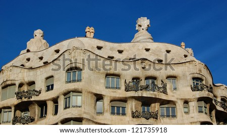 BARCELONA, SPAIN - DECEMBER 8: Casa Mila (La Pedrera) on December 8, 2009 in Barcelona, Spain. This famous building was designed by Antoni Gaudi.