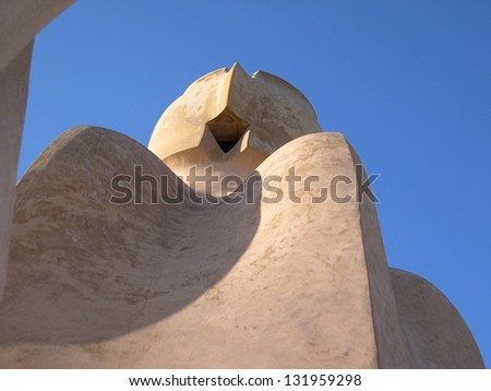BARCELONA, SPAIN - DECEMBER 30: Casa Mila or La Pedrera on December 30, 2005 in Barcelona, Spain. This famous building was designed by Antoni Gaudi and is one of the most visited of the city.