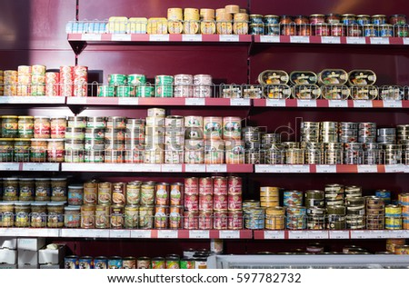 BARCELONA, SPAIN - FEBRUARY 02, 2016: Shelves with ordinary assortment of canned meat and fish products in East European food store #597782732