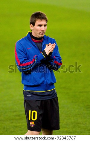 BARCELONA, SPAIN - JANUARY 8: Lionel Messi of FC Barcelona warm-upduring the Spanish league match between RCD Espanyol and FC Barcelona, final score 1-1, on January 8, 2012, in Barcelona, Spain.