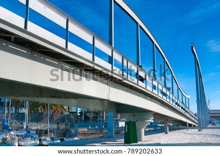 BARCELONA, SPAIN - JANUARY 02, 2018: Pedestrian bridge at Port Vell #789202633