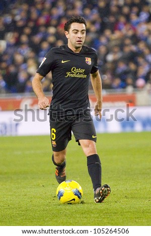 BARCELONA, SPAIN - JANUARY 8: Xavi Hernandez of Barcelona in action during the Spanish league match between RCD Espanyol and FC Barcelona, final score 1-1, on January 8, 2012, in Barcelona, Spain.
