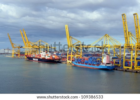 BARCELONA, SPAIN- JULY 16:A container ships are standing in Barcelona port on July 16,2012.  It is Catalonia's largest port with a trade volume of 2.57 million TEU's.