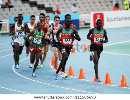 BARCELONA, SPAIN - JULY 15: Athletes compete in the 3000 metres steeplechase final on the 2012 IAAF World Junior Athletics Championships on July 15, 2012 in Barcelona, Spain.