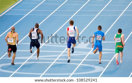 BARCELONA, SPAIN - JULY 27: Christophe Lemaitre (center) competes on the Men 100 m during the 20th European Athletics Championships at the Olympic Stadium on July 27, 2010 in Barcelona, Spain.