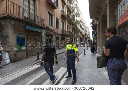 BARCELONA, SPAIN - JULY 29: Shooting in Barcelona\'s La Rambla leaves several people injured on July 29, 2015 in Barcelona, Spain. La Rambla is a bustling thoroughfare, which is popular with tourists.