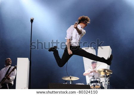 BARCELONA, SPAIN-JUN 25: Howlin' Pelle Almqvist, singer of The Hives band, performs at Universidad Complutense on June 25, 2011 in Madrid, Spain. First edition of Dcode Festival.
