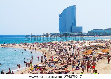 BARCELONA SPAIN JUNE 28 Barceloneta Beach against W Barcelona Hotel in June 28 2013 in Barcelona Spain Barceloneta Beach one of the most popular in the city