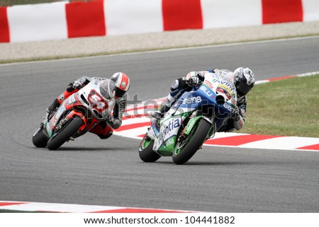 BARCELONA - SPAIN, JUNE 3: Colombian rider Yonny Hernandez leads Matia Pasini at 2012 Aperol MotoGP of Catalunya at Montmelo circuit on June 3, 2012