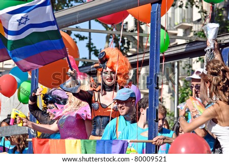 BARCELONA, SPAIN - JUNE 26: PRIDE BARCELONA Participants dance during the colorful and bright gay and lesbian pride parade on June 26, 2011 in the center of Barcelona, Spain.