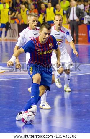 BARCELONA, SPAIN - JUNE 17: Sergio Lozano (9) of FCB in action at Spanish Futsal League final match between FC Barcelona and El Pozo Murcia, final score 4 - 1, on June 17, 2012, in Barcelona, Spain.
