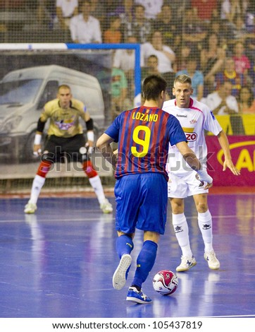 BARCELONA, SPAIN - JUNE 17: Sergio Lozano (9) of FCB in action at Spanish Futsal League final match between FC Barcelona and El Pozo Murcia, final score 4 - 1, on June 17, 2012, in Barcelona, Spain.