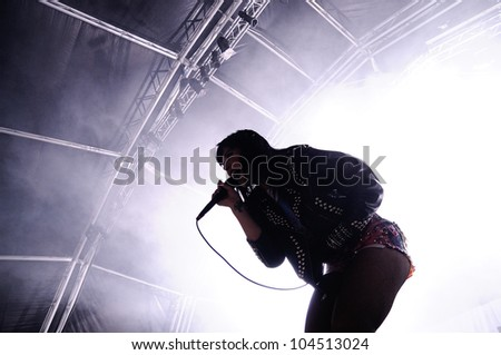 BARCELONA, SPAIN - JUNE 1: Silhouette of Alexis Krauss, singer of Sleigh Bells band, who performs at San Miguel Primavera Sound Festival on June 1, 2012 in Barcelona, Spain.