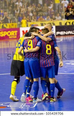 BARCELONA, SPAIN - JUNE 17: Some FCB players celebrating a goal at Spanish Futsal League final match between FC Barcelona and El Pozo Murcia, final score 4 - 1, on June 17, 2012, in Barcelona, Spain.