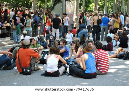 BARCELONA, SPAIN-JUNE 14, Students sitting on road near Parliament of Catalonia, June 14, 2011 in Barcelona, Spain. students against reduction of  social budget of country