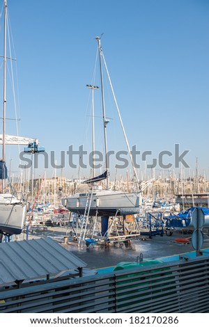 BARCELONA, SPAIN - MAR 15, 2014: Port Vell, the harbor in Barcelona,  built as part of an urban renewal program prior to the 1992 Barcelona Olympics. #182170286