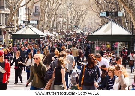 BARCELONA SPAIN MARCH 28 crowd at La Rambla in March 28 2013 in Barcelona Spain La Rambla one of symbol of city Center of touristic life
