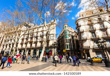 BARCELONA SPAIN MARCH 28 La Rambla in March 28 2013 in Barcelona Spain La Rambla one of symbol of city Located between El Raval and Barri Gotic districts
