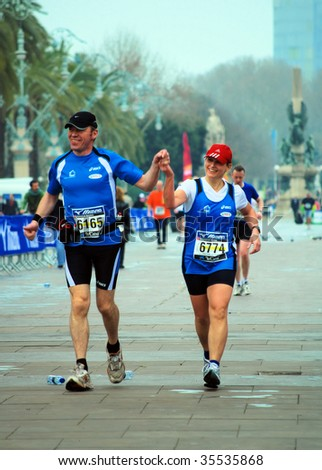 BARCELONA, SPAIN - MARCH 1: Participants during the International marathon on March 1, 2009 in Barcelona, Spain. The marathon runs the Extent of 42195 metres in the city.