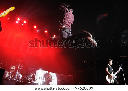 "BARCELONA, SPAIN - MARCH 13: Pierre Bouvier, frontman of Simple Plan band, jumps at Razzmatazz on March 13, 2012 in Barcelona, Spain. The band is currently on their ""Get Your Heart On!"" tour."