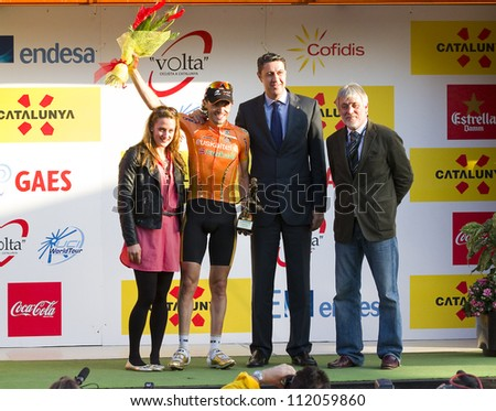 BARCELONA, SPAIN - MARCH 24: Samuel Sanchez (orange jersey) of Euskaltel team wins the Stage 6 of Volta a Catalunya cycling race, on March 24, 2012, in Barcelona, Spain.