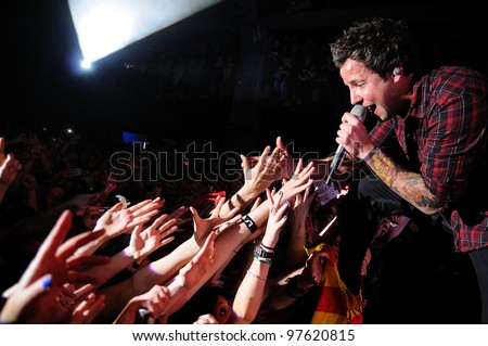 "BARCELONA, SPAIN - MARCH 13: Simple Plan band performs at Razzmatazz on March 13, 2012 in Barcelona, Spain. The band is currently on their ""Get Your Heart On!"" tour."