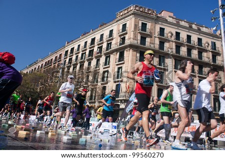 BARCELONA, SPAIN - MARCH 25:  unidentified athletes participate in the Barcelona marathon on March 25, 2012 in Barcelona, Spain. Over 15.000 runners took part in the 2012 edition.