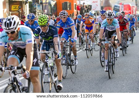 BARCELONA, SPAIN - MARCH 24: Unidentified cyclists compete at Volta a Catalunya cycling race, on March 24, 2012, in Barcelona, Spain. - stock photo