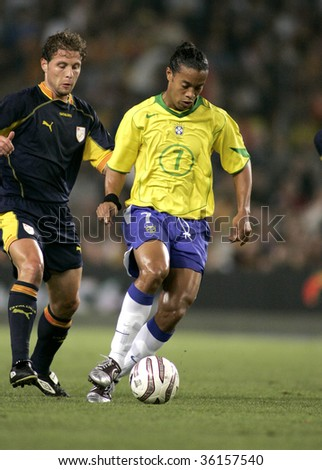 BARCELONA, SPAIN - MAY. 25: Brazilian player Ronaldinho in action during the friendly match between Catalonia vs Brazil at Nou Camp Stadium in Barcelona, Spain. May 25, 2004. - stock photo