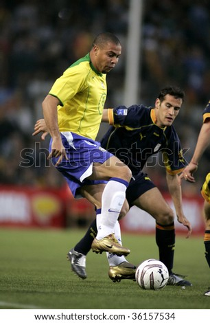 BARCELONA, SPAIN - MAY. 25: Brazilian player Ronaldo in action during the friendly match between Catalonia vs Brazil at Nou Camp Stadium in Barcelona, Spain. May 25, 2004. - stock photo