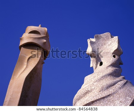 BARCELONA, SPAIN-MAY 5: Chimneys on the roof of La Pedrera, or Casa Mila by Antonio Gaudi, the exponent of Catalan Modernism on May 5,2010 in Barcelona, Spain.