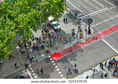 BARCELONA, SPAIN - MAY 02: Looking Down at Busy Street Intersection with Pedestrian Cross Walks, as seen from Casa Mila, Barcelona, Spain. May 02, 2015.