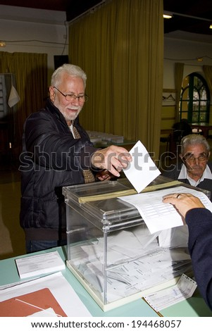 BARCELONA, SPAIN - NOVEMBER 25: An unidentified man delivers his vote in a polling station during Catalonian parliamentary election, on November 25, 2012 in Barcelona, Spain.