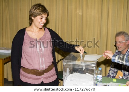 BARCELONA, SPAIN - NOVEMBER 20: An unidentified woman delivers her vote in a polling station during Spanish General Elections on November 20, 2011 in Barcelona, Spain.