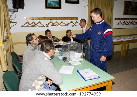 BARCELONA, SPAIN - NOVEMBER 25: An unidentified woman delivers his vote in a polling station during Catalonian parliamentary election, on November 25, 2012 in Barcelona, Spain.