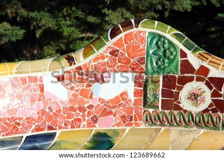 "BARCELONA, SPAIN - NOVEMBER 6: Ceramic art in Park Guell on November 6, 2012 in Barcelona, Spain. It was built in 1900-14 and  is part of the UNESCO World Heritage Site ""Works of Antoni Gaudi""."