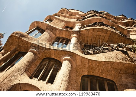 BARCELONA, SPAIN - OCTOBER 4: Casa Mila or La Pedrera on October 4, 2012 in Barcelona, Spain. This famous building was designed by Antoni Gaudi and is one of the most visited of the city.