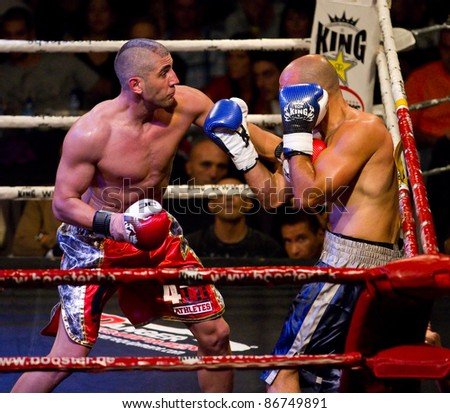 BARCELONA, SPAIN - OCTOBER 15: Cesar Cordoba (L) and Nuno Lagarto fight at the fight4life Boxing - 86 kg event, on October 15, 2011, in Barcelona, Spain.