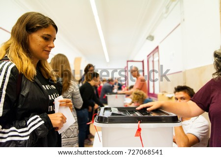 barcelona, Spain - 01 October 2017: people voting during illegal referendum for catalan indepedence #727068541