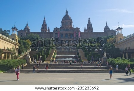 BARCELONA, SPAIN, OCTOBER 23, 2014: Plaza espana in barcelona is a famous place for its magic fountain show, artificial waterfall, national museum and dozens of tourist admiring all of them.