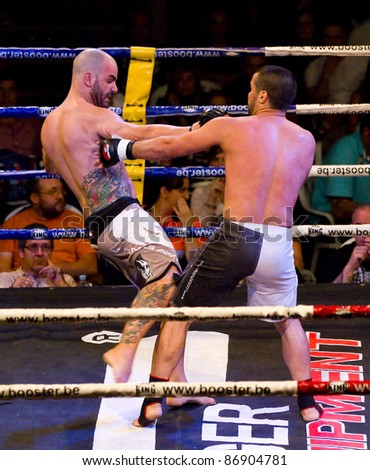BARCELONA, SPAIN - OCTOBER 15: Ray Boixader (L) and Juan Carlos Portillo fight at the fight4life MMA - 80 kg event, on October 15, 2011, in Barcelona, Spain.