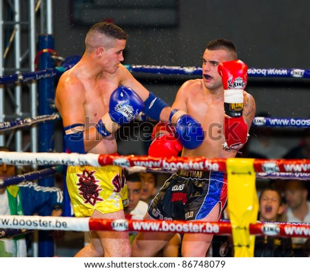 BARCELONA, SPAIN - OCTOBER 15: Souffian Harrak (L) and Miguel Diaz fight at the fight4life Muay Thai - 72 kg event, on October 15, 2011, in Barcelona, Spain.