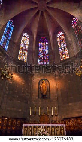 BARCELONA, SPAIN--OCTOBER 19:Stained glass, Mary statue with altar in St Maria del Pi, Saint Mary of Pine Tree, in Barcelona, Spain on October 19, 2012. One of the oldest churches in Barcelona.